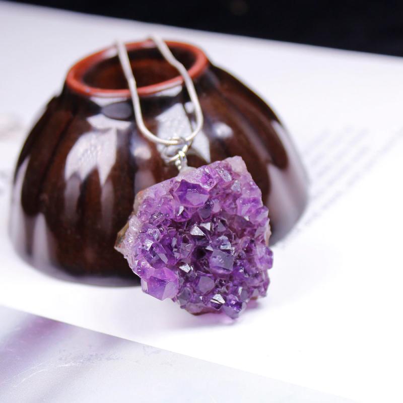 Amethyst pendant on table