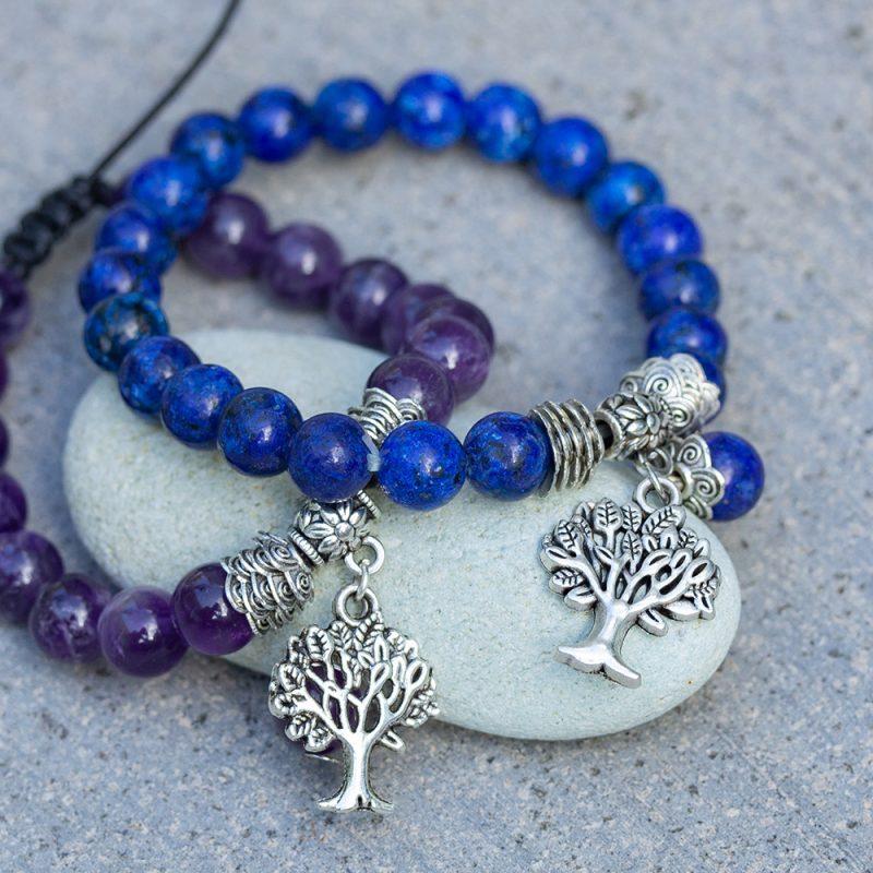 Lapis Lazuli and Amethyst Bracelets on a pebble